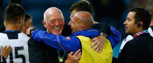 Coach Lynn Howells celebrates Romania's win over Canada in the 2015 World Cup