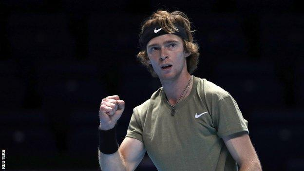 Andrey Rublev celebrates a point in his match against Dominic Thiem at the ATP Finals in London