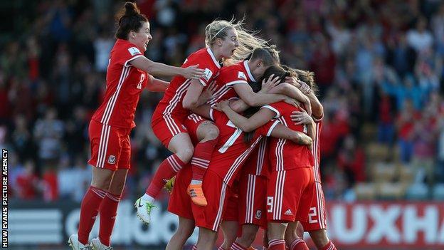 Wales women celebrate a goal