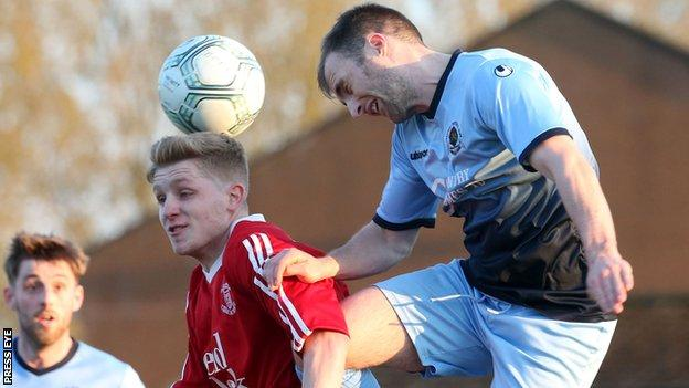 Ballyclare goal-scorer Corey McMullan and Institute's Niall Grace in aerial action at Dixon Park