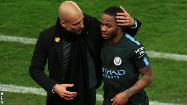 Raheem Sterling with Manchester City manager Pep Guardiola