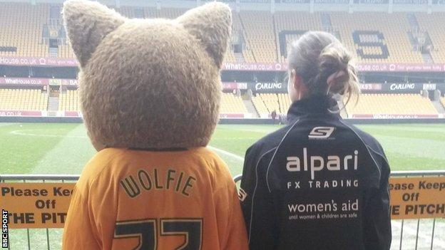 Charlie Webster with Wolfie, mascot of Wolverhampton Wanderers