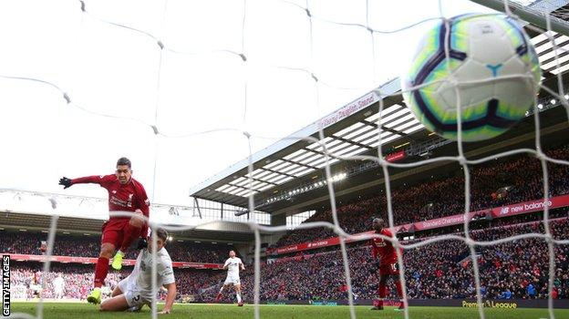 Roberto Firmino scores his second goal in Liverpool's 4-2 win over Burnley on 10 March