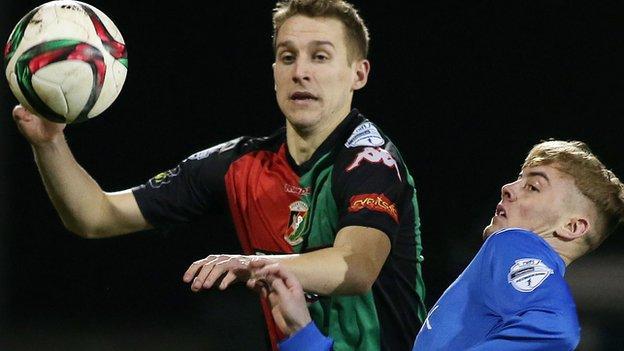 Johnny Addis of Glentoran in action against Glenavon's Mark Sykes