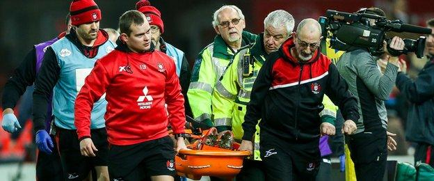 Billy Burns leaves field on stretcher