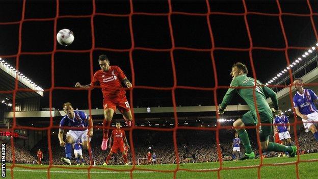 Liverpool striker Danny Ings scores against Carlisle