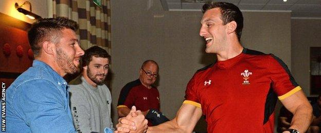 Rhys Webb presents Wales captain Sam Warburton with his match jersey for Fiji