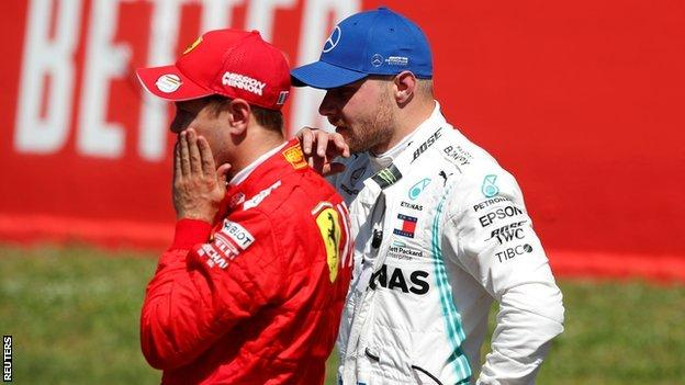 Ferrari's Sebastian Vettel and Mercedes' Valtteri Bottas after qualifying
