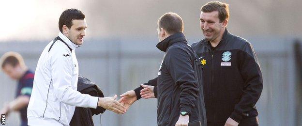 Ian Murray, while manager of Dumbarton, shakes hands Hibernian boss Alan Stubbs
