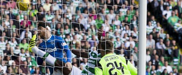 Rangers' Joe Garner heads in at Celtic Park