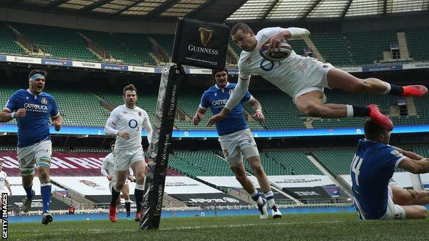 Jonny May jumps in the air to score a try