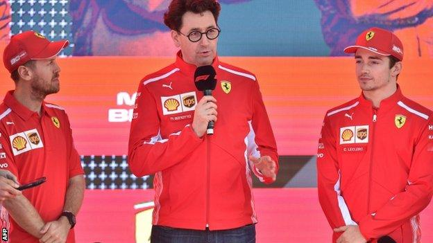 Sebastian Vettel, Ferrari team principal Mattia Binotto and Charles Leclerc