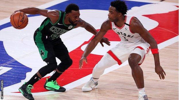Boston Celtics' Brad Wanamaker tries to get past Toronto Raptors' OG Anunoby