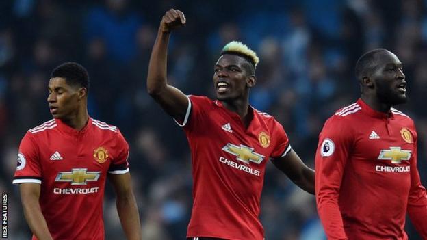 Paul Pogba celebrates Manchester United's win over Manchester City