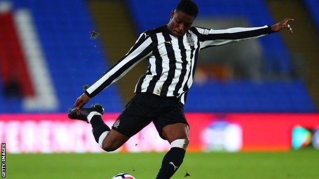 Deese Kasinga kicking a football