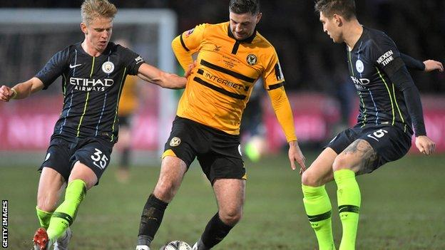 Padraig Amond in action against Manchester City