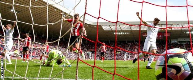 The ball rests in the net after Kyle Naughton scores