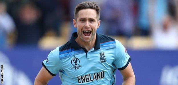 England bowler Chris Woakes celebrates dismissing David Warner in the World Cup semi-final against Australia