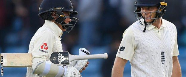 Sam Curran and Jos Buttler walk off at the close