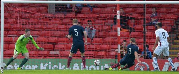 Scotland Under-21s' Stephen Kingsley's scores an own goal in the match against France