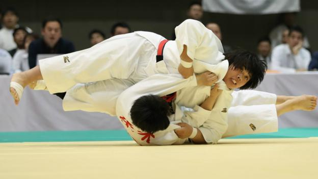 YOKOHAMA, JAPAN - APRIL 21: Akira Sone (top) compete against Chie Sasaki in the third round match during the All Japan Women's Judo Championship at Yokohama Cultural Gymnasium on April 21, 2019 in Yokohama, Kanagawa, Japan. (Photo by Takashi Aoyama/Getty Images)