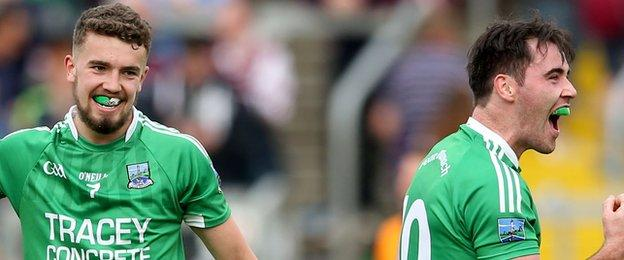 Fermanagh's James McMahon and Barry Mulrone celebrate after the game