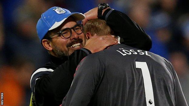 Huddersfield boss David Wagner celebrates with keeper Jonas Lossl