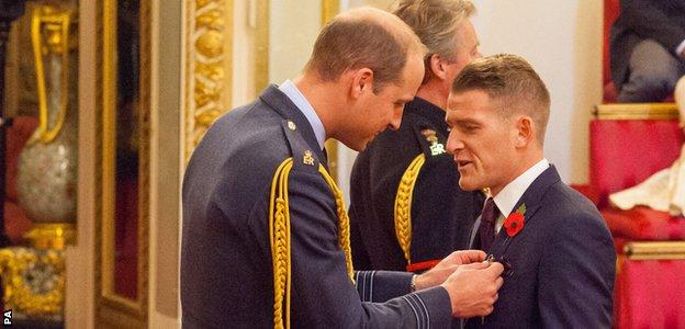 Steven Davis received his honour from the Duke of Cambridge at Buckingham Palace