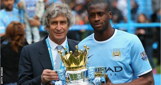 Manchester City manager Manuel Pellegrini and Yaya Toure
