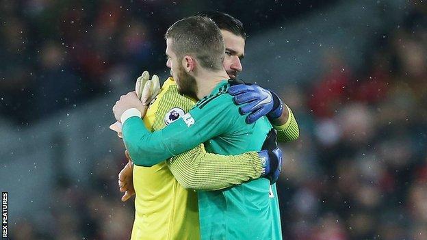 Alisson and De Gea hug
