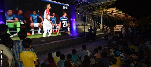 Fans in public areas in Lahore watch this summer's World Cup final