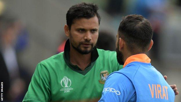 Bangladesh fast bowler Mashrafe Mortaza shakes hands with India captain Virat Kohli