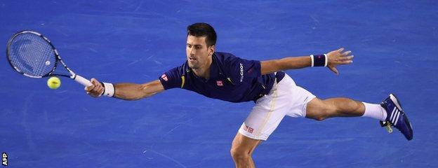 Novak Djokovic stretches for a forehand
