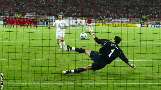 Liverpool keeper Jerzy Dudek saves Andriy Shevchenko's penalty to clinch a 3-2 shoot-out victory for the Reds