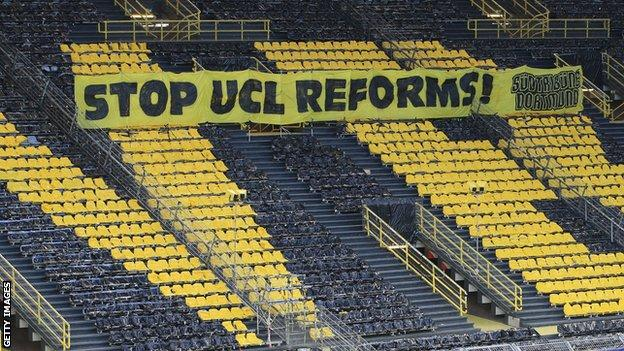 A banner against Champions League reforms was in the stands of Borussia Dortmund's stadium during their Champions League quarter-final against Manchester City