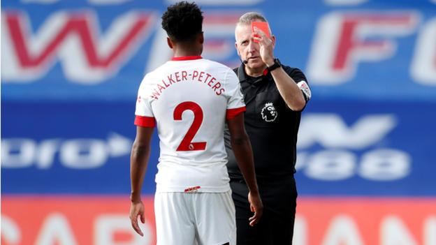 Kyle Walker-Peters is shown a red card by referee Jonathan Moss
