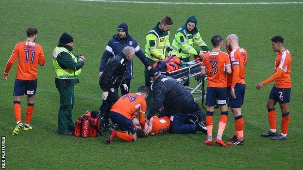 Luke Berry surrounded by paramedics