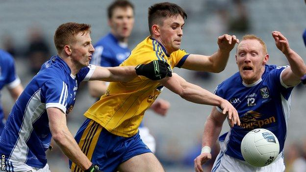 Cavan pair Jason McLoughlin and Cian Mackey challenge Roscommon's Brian Stack