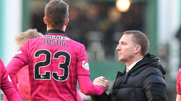 Celtic's Mikeal Lustig is congratulated by Brendan Rodgers