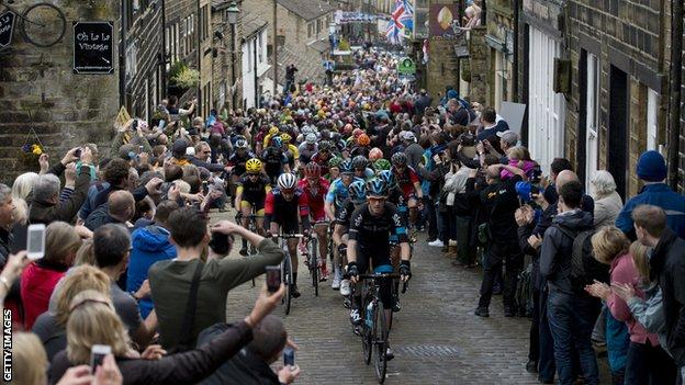 The peloton rides through Haworth