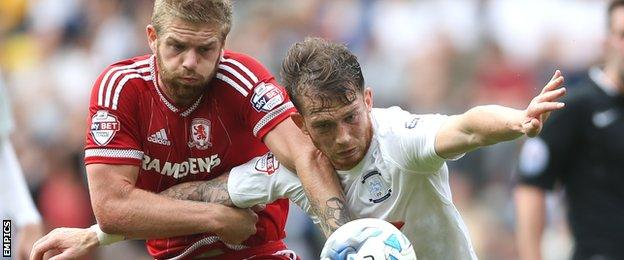 Middlesbrough's Adam Clayton (right) and Preston North End's Joe Garner battle for the ball