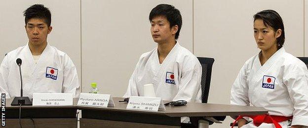Athletes Hiroto Shinohara, Ryutaro Araga, and Kiyou Shimizu of the World Karate Federation (WKF) give a presentation