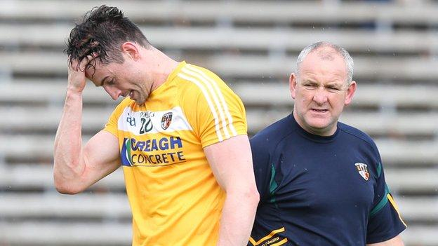 Antrim midfielder Niall McKeever with joint-manager Frank Fitzsimons