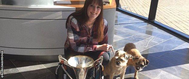 Ruth with her dogs Lou and Sid and the National League North Champions Trophy