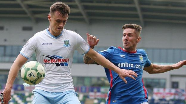 Scot Whiteside and Daniel Kearns in action during Linfield's 1-0 league win over Ballymena last month