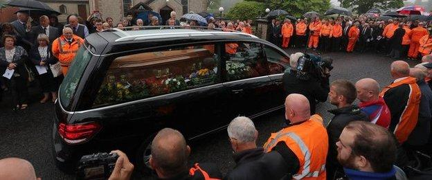The funeral cortege arrives at Garryduff Presbyterian Church for William Dunlop's funeral