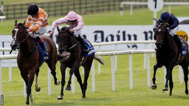 Covert Love wins The Irish Oaks by a length and three-quarters at The Curragh