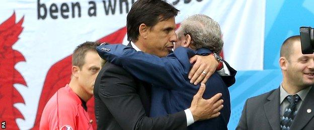 Chris Coleman and Roy Hodgson embrace at full-time in Lens