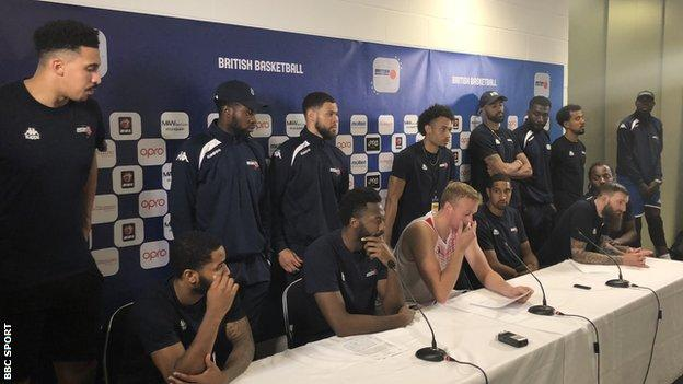 Members of GB's basketball team read a statement at a post-match press conference