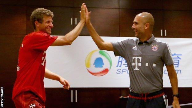 Bayern Munich striker Thomas Muller (left) and manager Pep Guardiola